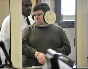 Newton library worker Peter Buchanan was lead into Newton District Court… (Josh Reynolds for The Boston Globe) I Love Newton