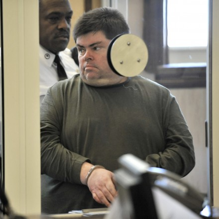 Newton library worker Peter Buchanan was lead into Newton District Court… (Josh Reynolds for The Boston Globe) I Love Newton